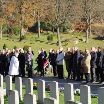 Start of the proceedings at the commonwealth grave site. The gentleman in the trench-coat holding a wreath in front of him is the second in charge at the British Embassy in Stockholm and behind him in the dark coat and glasses is the British Consul in Gothenburg. Far to the left is the Swedish Military (Air Force) representative. Behind the German Military attaché is me with sunglasses and Russell Travers behind me in the beret.