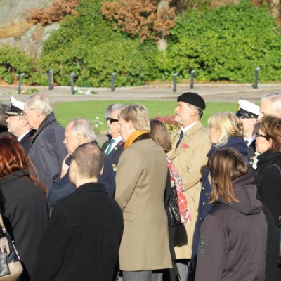 At the German grave site with me with sunglasses behind the gentleman in the light coat and scarf and behind me wearing a trench-coat and beret is Russell Travers