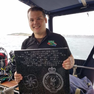 Lgr Claudio Chiste with plaque before the dive  It reads 'In remembrance of the nearly 900 men of the SS Mendi, 616 of whom bravely gave their tomorrow for our today. NOT FOR OURSELVES BUT FOR OTHERS. Placed on behalf of the South African Legion 08.08.2017'. NOT FOR OURSELVES, BUT FOR OTHERS  Photo courtesy of Martin Davies